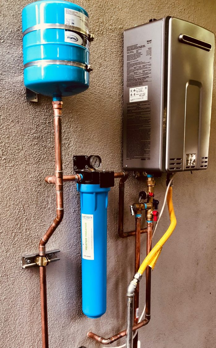 A tankless water heater attached to a wall